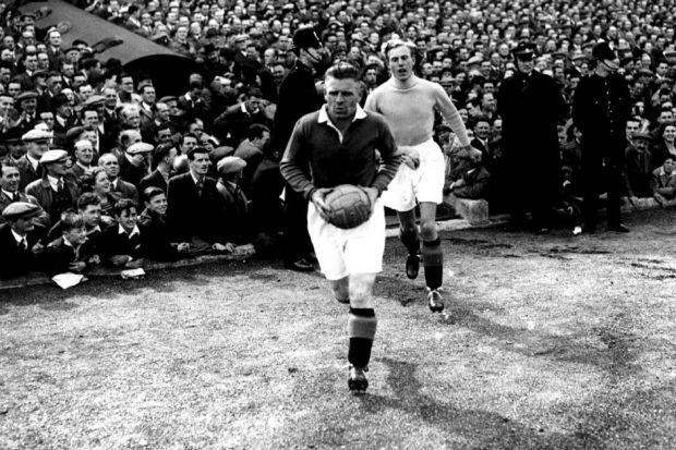 Goalkeeper Bobby Brown, running out here behind Rangers captain Jock Shaw in 1947, played for both clubs Photograph: Newsquest Archive