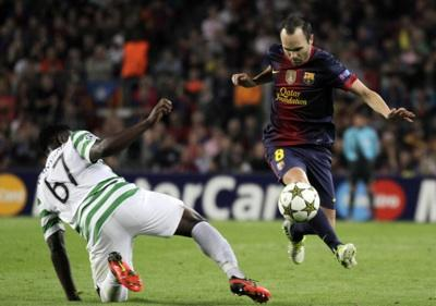 In exalted company: Victor Wanyama takes on Andres Iniesta in the Nou Camp