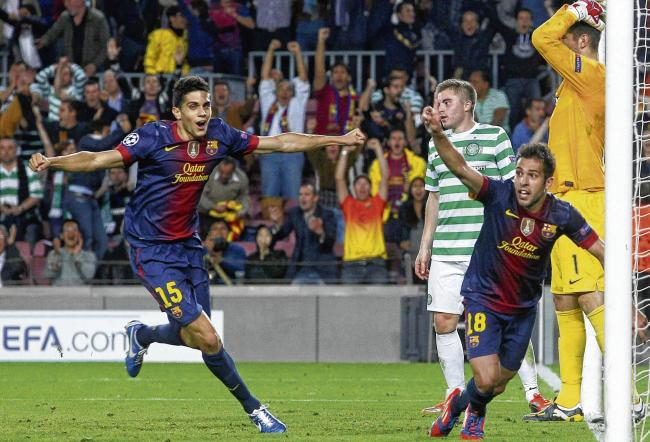 BARCELONA2 CELTIC1 Marc Bartra, left, celebrates with goalscorer Jordi Alba, foreground, as James Forrest and Fraser Forster are left dismayed.  Picture: Albert Gea/Reuters