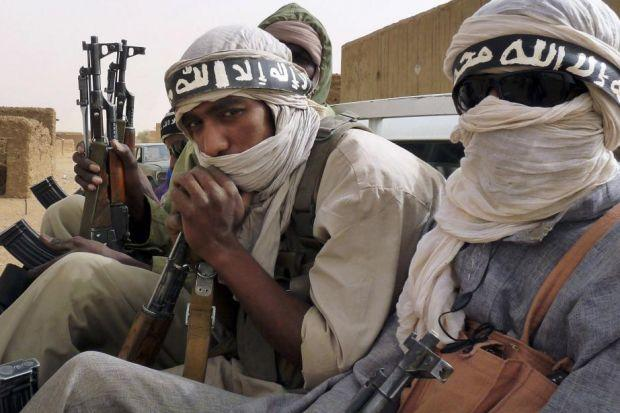 ARMED AND DANGEROUS: Militiaman from the militant Islamic group Ansar Dine are fighting on al Qaeda's behalf in Mali. Picture: Reuters