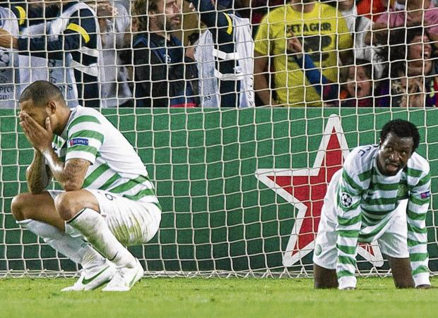 Kelvin Wilson and Efe Ambrose, right, are left shattered after a late goal from Barcelona's Jordi Alba (not in picture) seals victory for the Catalans. Picture: Craig Williamson/SNS