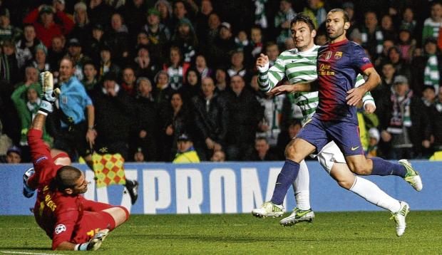Tony Watt slides a shot beyond  Victor Valdes to give Celtic a  two-goal lead late in the game. Picture: Colin Mearns