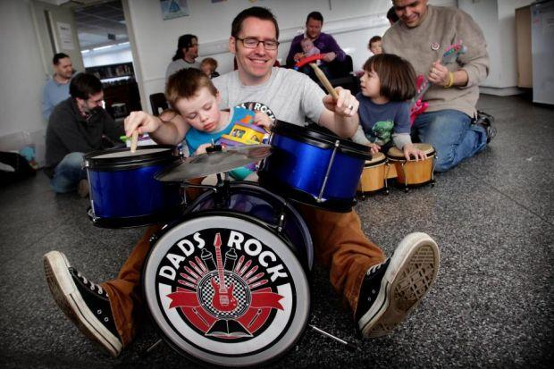 Thomas Lynch, above, with son Lewis, co-founded fathers-only playgroup Dads Rock to fill a gap in the market