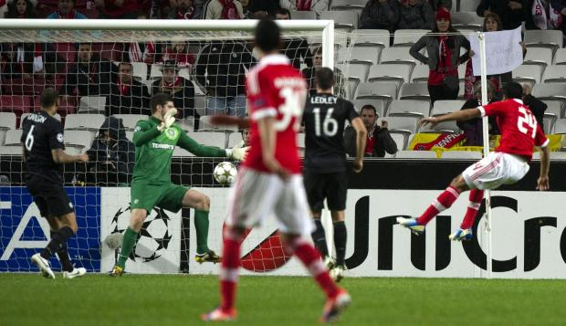 Ezequiel Garay volleys past Fraser Forster to secure the win Benfica craved