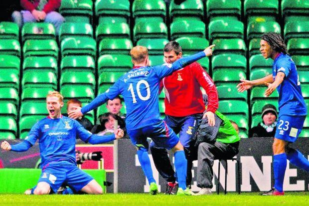 Billy McKay celebrates with his Inverness team-mates after scoring the goal that beat Celtic    Photograph: SNS