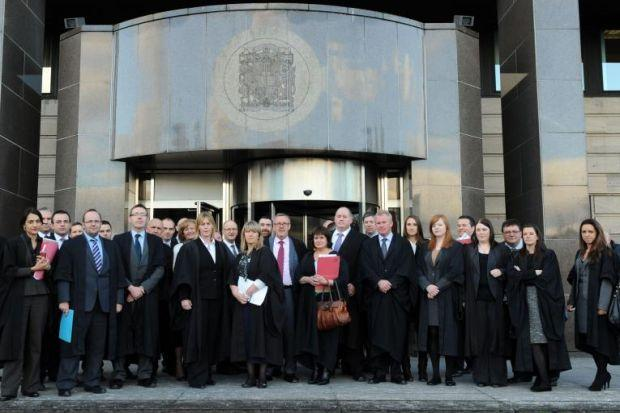 CASE FOR THE DEFENCE: Lawyers walk out of Glasgow Sheriff Court. Picture: James Galloway