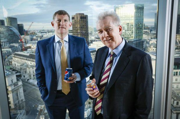 MERGER AGREEMENT: AG Barr's chief executive Roger White, left, and John Gibney, finance director at Britvic. Picture: Chris Winter.