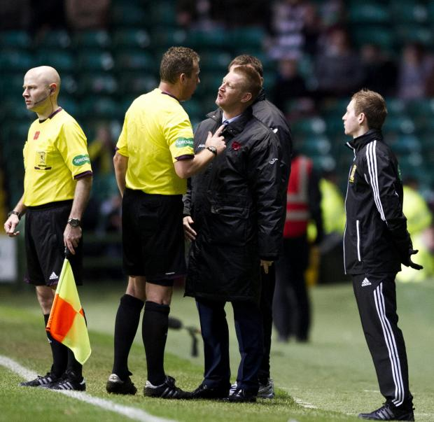 Iain Brines and Steve Lomas exchange  views at Celtic Park. The St Johnstone  manager was sent to the stand and has  subsequently received an eight-match ban.