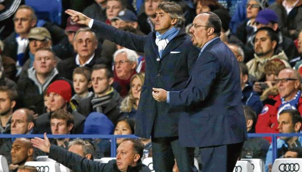 Chelsea's interim coach Rafael Benitez, right, and Manchester City manager Roberto Mancini. Picture: Reuters