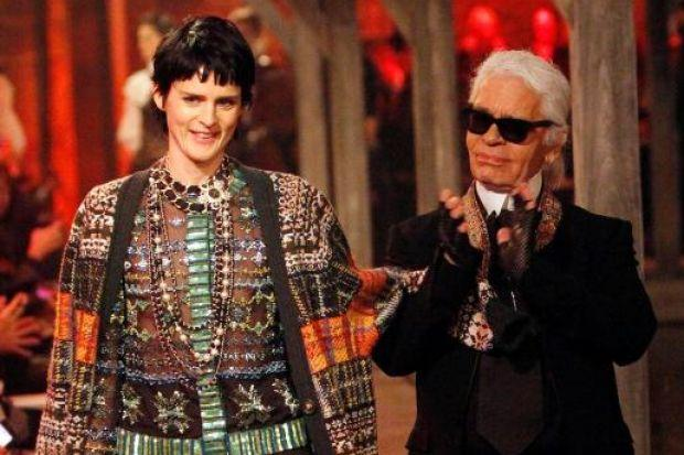 MODEL NIGHT: Karl Lagerfeld with a model at the show in Linlithgow Palace. Picture: Mark Mainz