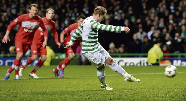 Kris Commons considered dinking  in his late penalty, before deciding  to smash it