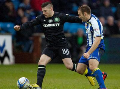 Gary Hooper shields the ball from Liam Kelly