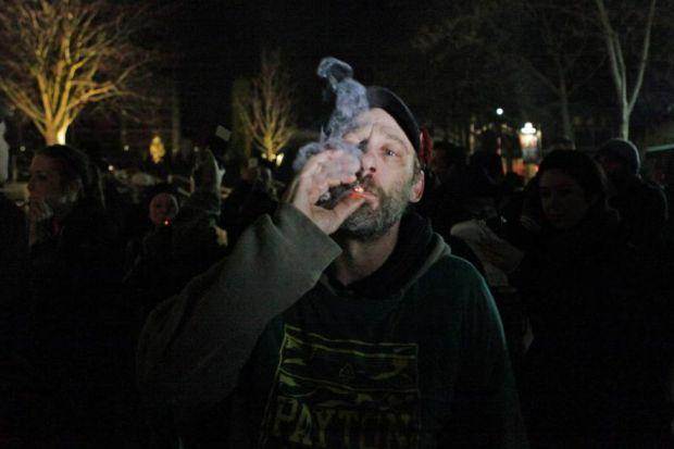 A man lights up after the law legalising the recreational use of marijuana went into effect in Seattle, Washington