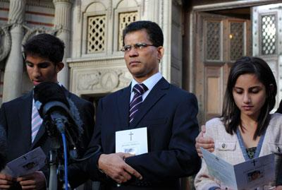 Benedict Barboza outside Westminster Cathedral with son Junal, 16, and daughter Lisha, 14