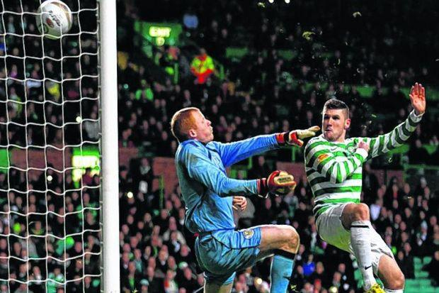Gary Hooper sends Celtic's second into the net	 Photograph: SNS