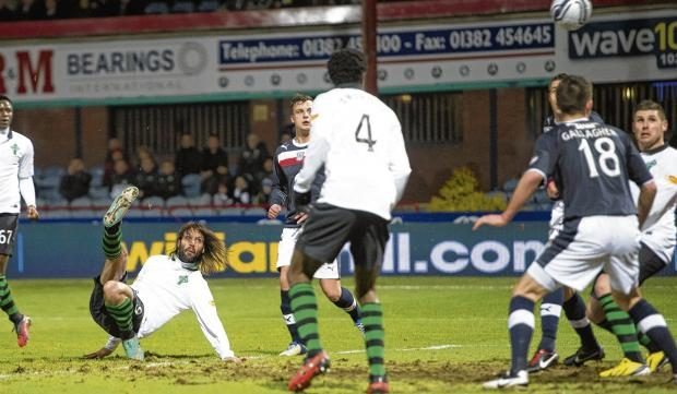 Samaras lands on the deck as his overhead kick finds the net. Picture: Craig Williamson/SNS