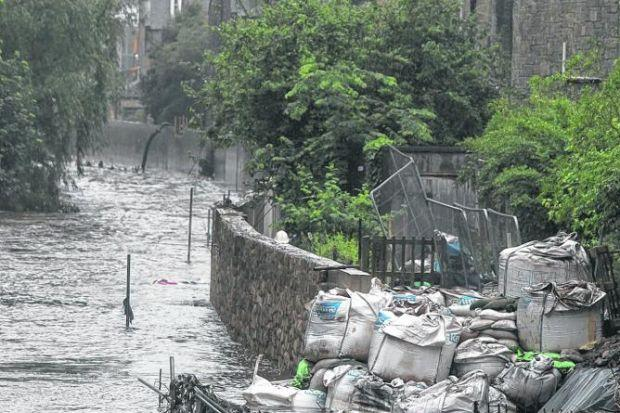 DEVASTATION: Flood prevention work at the Stockbridge Colonies in Edinburgh has caused chaos. Picture: Gordon Terris