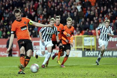 Dundee United's Jon Daly scores a penalty during the match against St Mirren