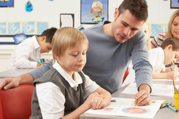 LESSON IN LIFE: A male teacher acts as a role model for boys, but male and female staff are not equally represented in the classroom.