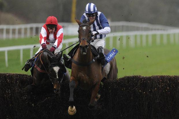 Monbeg Dude, left, clears the last before overtaking Teaforthree at Chepstow   Photograph: Getty