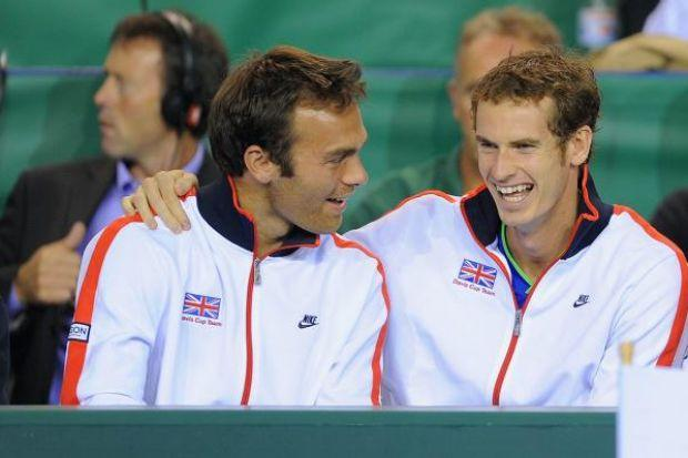 dedication: Brisbane International champion Andy Murray with Ross Hutchins before the doubles champion was diagnosed with a form of  cancer. Picture: Getty Images