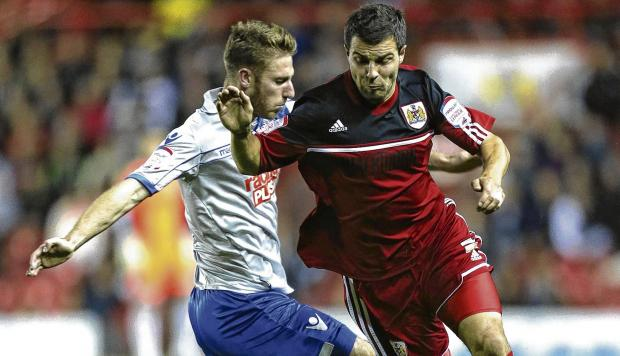 Richard Foster, right, admits he has had to 'adapt his game' after his move to Bristol City