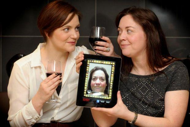 FACE IT: The smartphone app lets women hold up a mirror to their drinking
