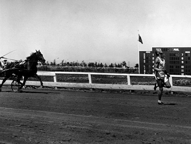A seven-year-old pacer horse is no match for Jesse Owens at Bay Meadows in 1948. Picture: Planet News
