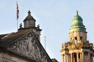 Union flag flies over Belfast City Hall after violent clashes