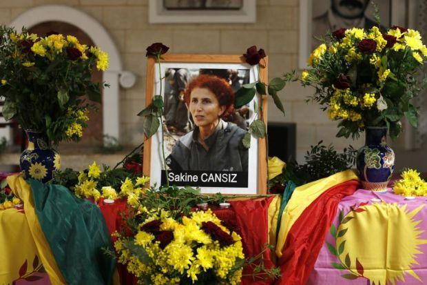 TRIBUTE: A portait of murdered PKK activist Sakine Cansiz is displayed outside the Kurdish cultural centre in Paris yesterday. Picture: Reuters