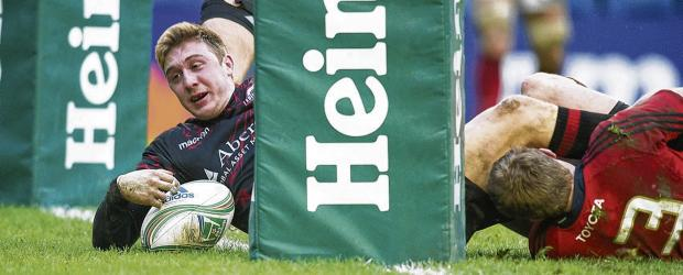 Edinburgh wing Dougie Fife scores between the posts for his second try
