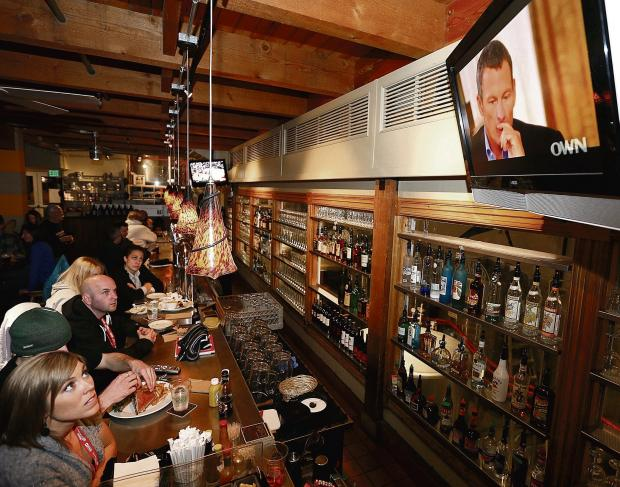 Patrons at a bar in Park City, Utah, watch intently as Oprah Winfrey's interview with Lance Armstrong is aired. Picture: George Frey/EPA