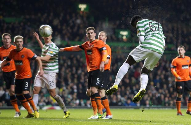 Victor Wanyama rises unchallenged to plant a header beyond Radoslaw Cierzniak and put Celtic 2-0 ahead before the interval