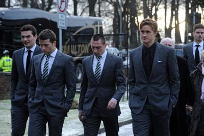 The current Celtic squad at Fallon's funeral