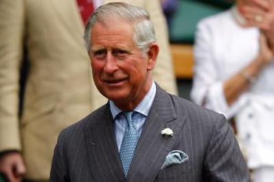 Prince Charles throws paper planes at media after comparing Putin to Hitler