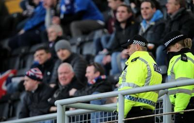 Police watch over fans during the William Hill Scottish Cup, Fifth Round match at Tannadice Park, Dundee.