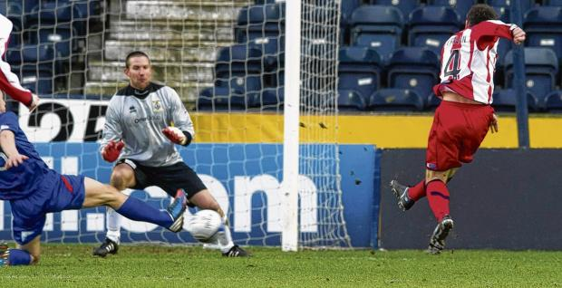 Paul Heffernan scores the first of his two goals. Picture: SNS