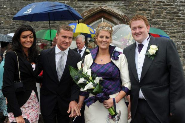 WEDDING DAY: David Coultard, left, with fiancee Karen Minier at the marriage of his sister Lynsay to William Jackson.