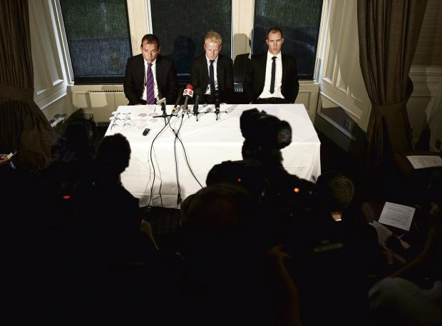 Solicitor Simon Catto speaks to the press on behalf of Steven Naismith, centre, and Steven Whittaker