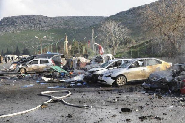 CLASHES: Damaged cars after an explosion at the town of Reyhanli on the Turkish-Syrian border.