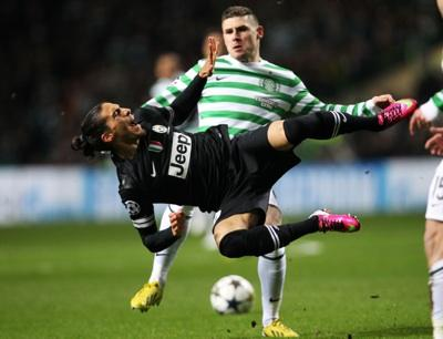 Gary Hooper and Juventus's Martin Caceres tangle