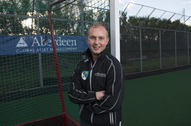 John McKnight left the security of a job as a PE teacher to become one of three full-time hockey coaches in Scotland, but he has no regrets