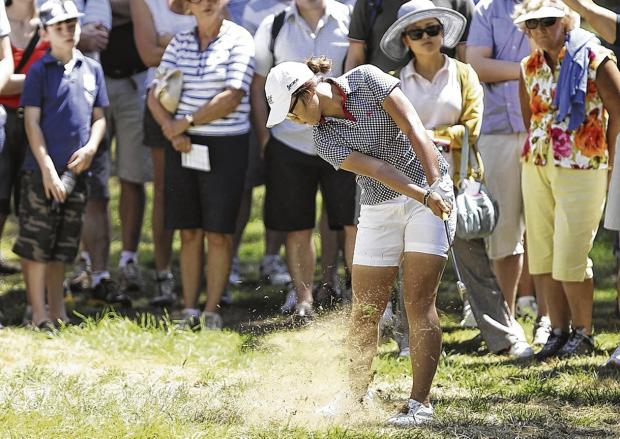 Lydia Ko hits out of the rough at the first hole on the final day of the ISPS Handa Australian Open at Royal Canberra G