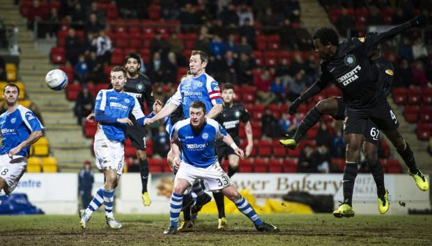 Efe Ambrose opens the scoring for Celtic at McDiarmid Park last night. Picture: SNS