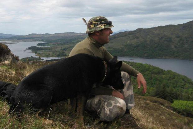 ONE MAN AND HIS DOG: Wayne Hall is setting off on a six-month charity trek across Scotland with his German shepherd Jerry. Picture: PA
