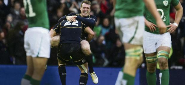 Stuart Hogg and Duncan Weir celebrate Sunday's victory over Ireland at Murrayfield. Picture: PA