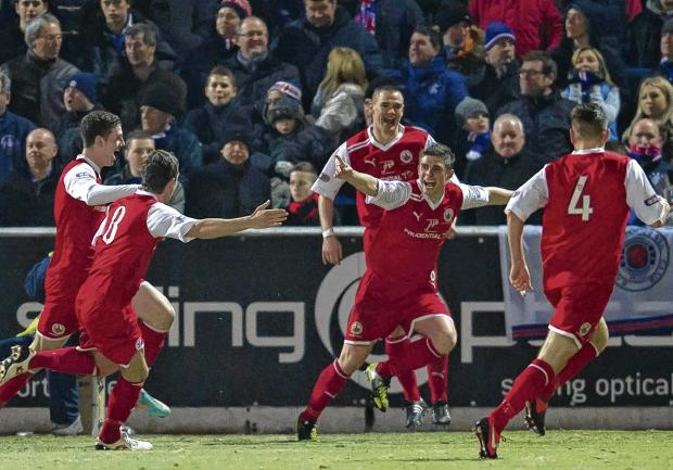 Stirling Albion's Ross Forsyth, second from right, wheels away in celebration after levelling the scores