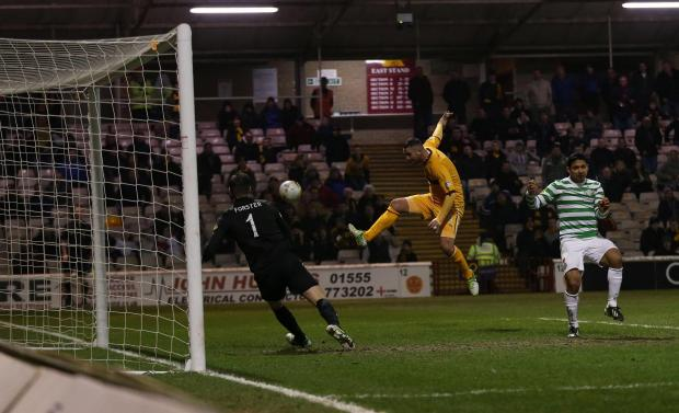 Fraser Forster cannot prevent Michael Higdon  securing the points for Motherwell