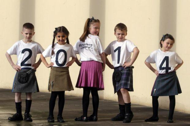 DRESSED FOR THE OCCASION: Children from Pathhead Primary School, Kirkcaldy put on their kilts and T-shirts to spell out Homecoming 2014 at the launch at Hopetoun House in South Queensferry, Edinburgh. Around 100 events are planning during the year. Pictur