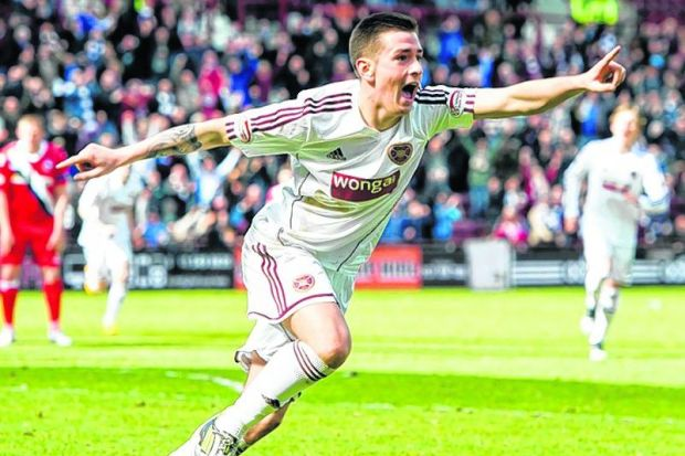 Jamie Walker celebrates putting Hearts 3-2 in front     Photograph: SNS